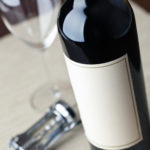 Bottle of red with blank label and glass - 55491760