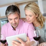 Couple drinking wine while looking at an Ipad 150x150 - Mexicans wave hello to wine