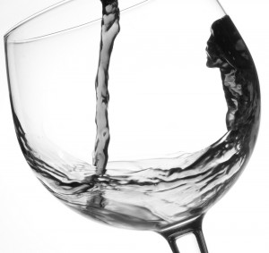 wine jet breaking into glass 300x283 - Enough to drive you to drink