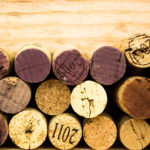 Corks against wood background