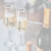 Two champagne glasses with bottle adjacent